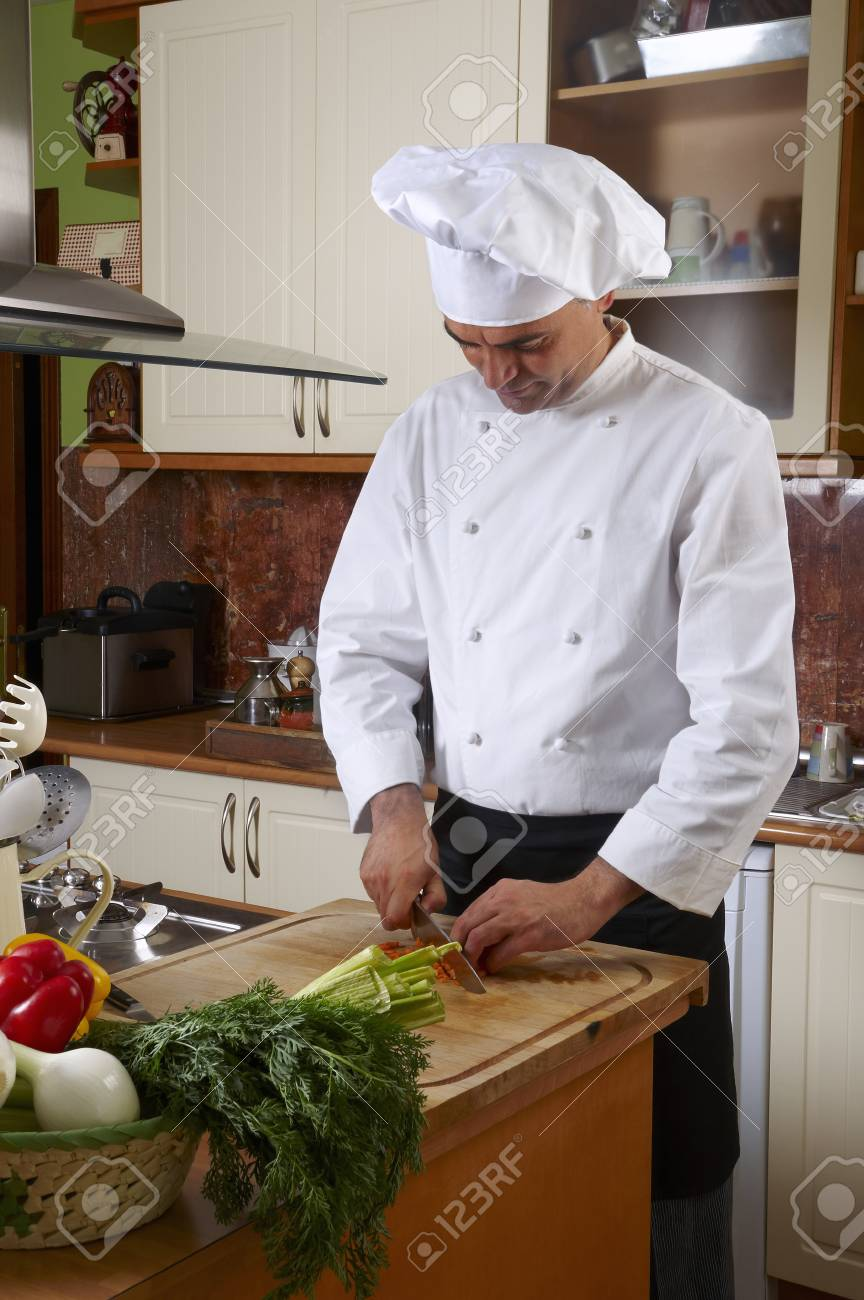 Chef cutting vegetables - 38156221