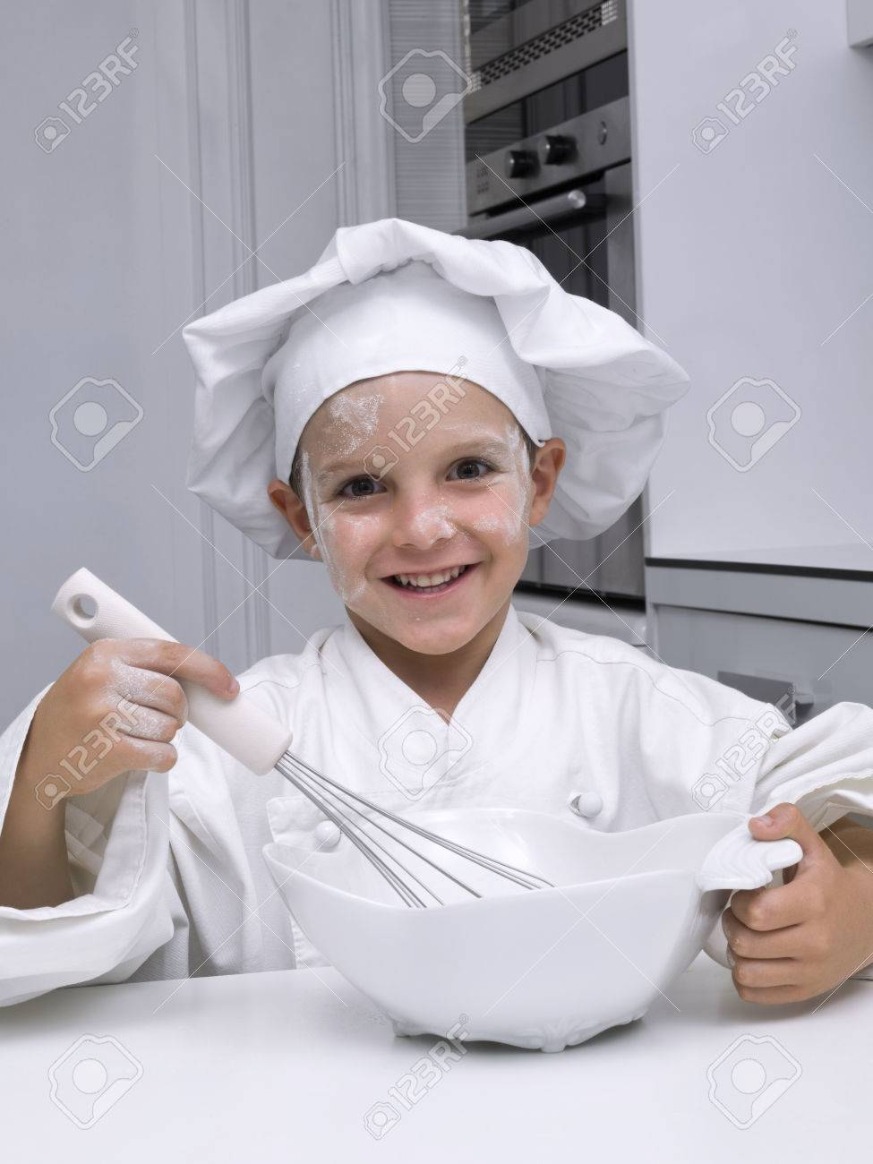 Children, dressed as a chef, with A beater in the hand - 38156224