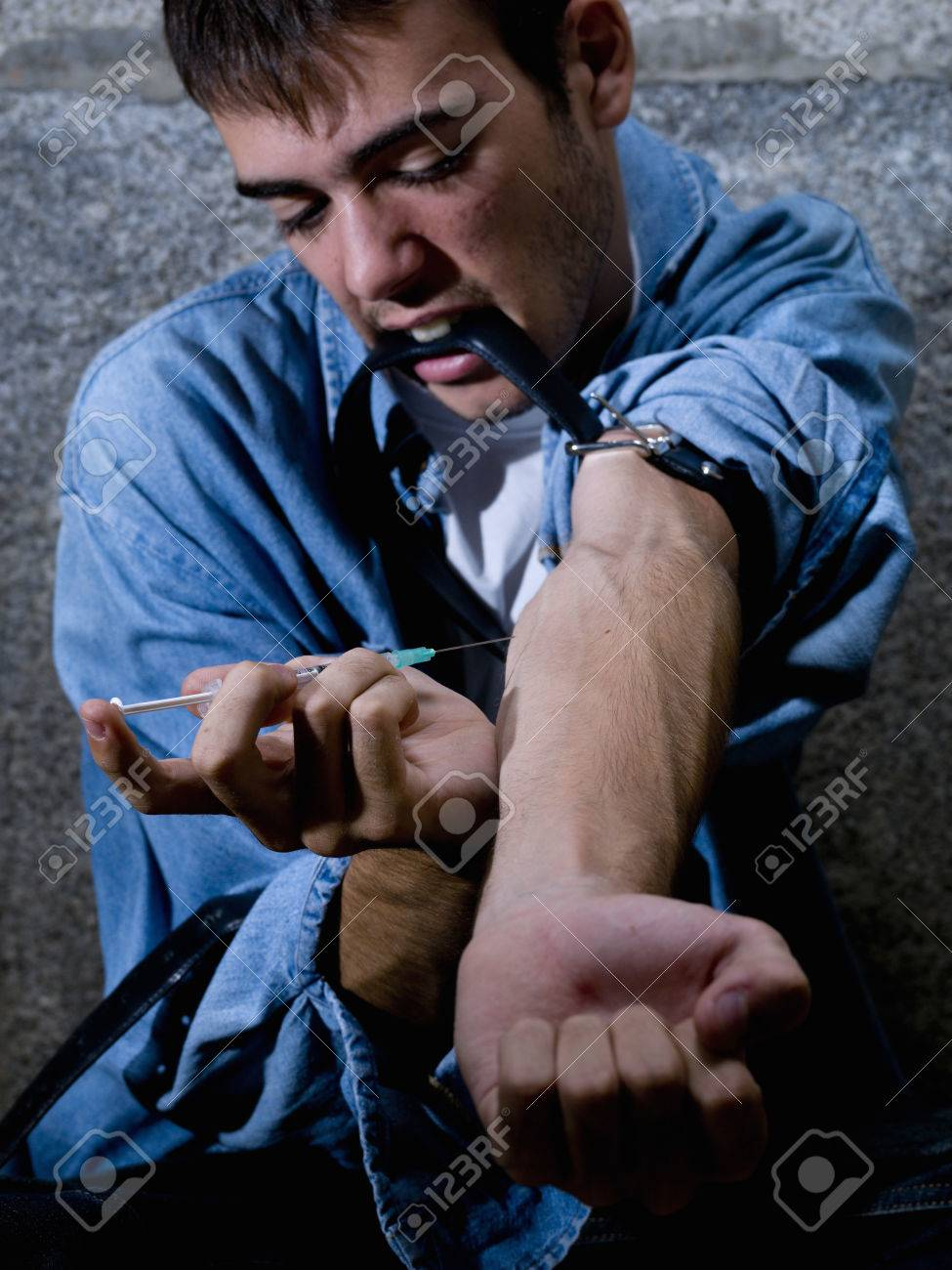 Young drug addict, drug being injected - 38156374
