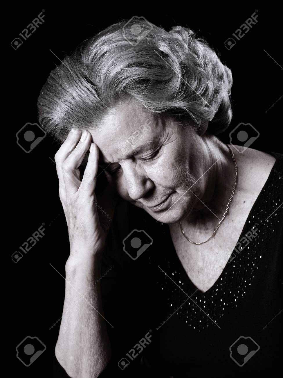 Elderly woman resting her head by having a pain - 38160269