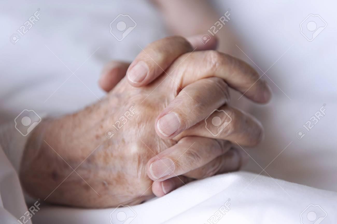 Hands of an elderly man - 38161297