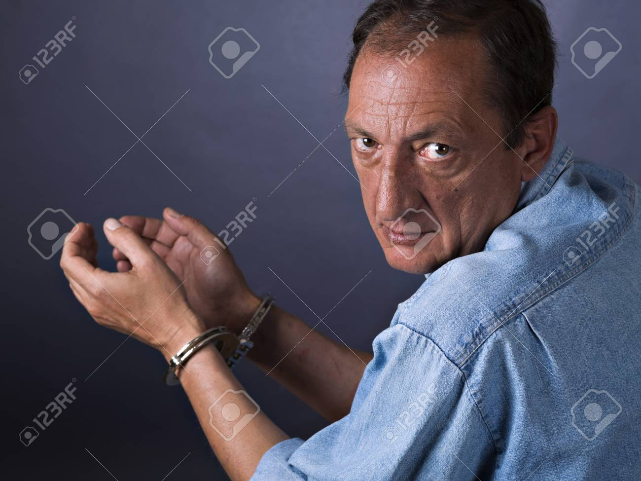 Man, mature, with handcuffs - 38161571