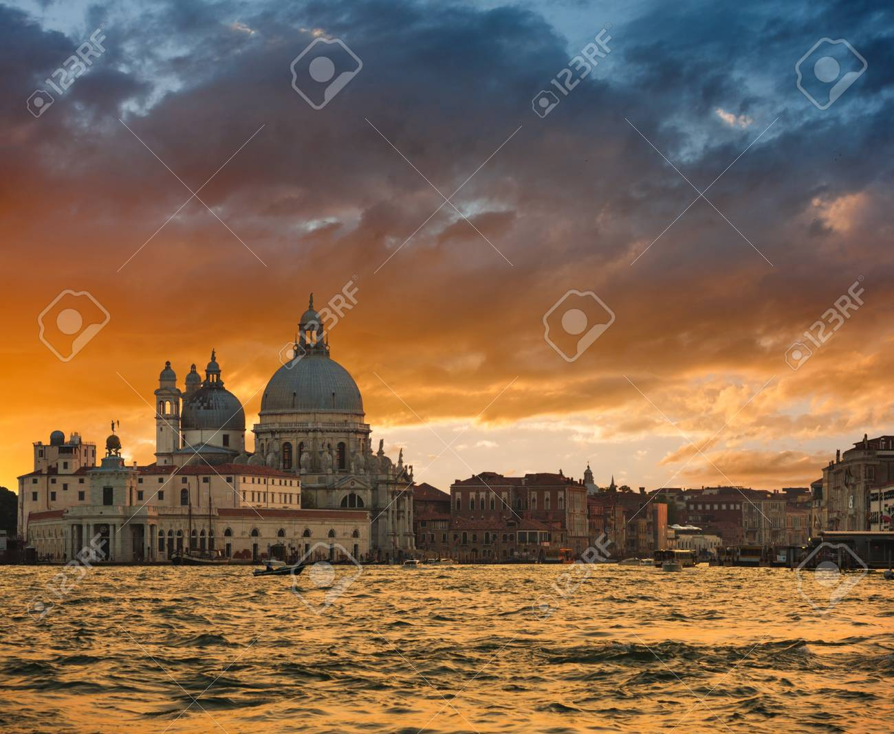 Gorgeous sunset over Grand Canal and Basilica Santa Maria della Salute, Venice, Italy Stock Photo - 18078559