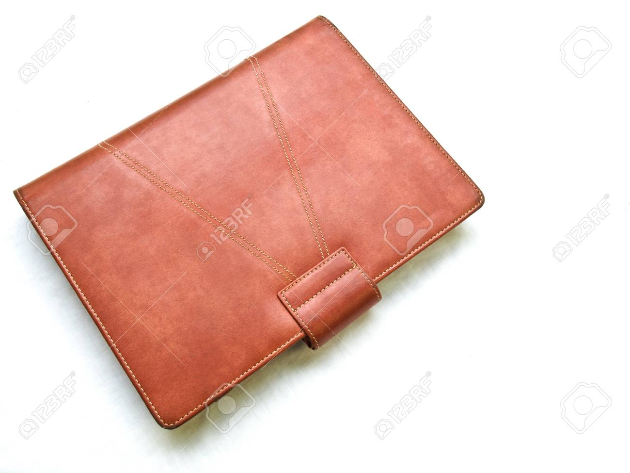 Red brown leather organizer isolated by white Stock Photo - 17529446
