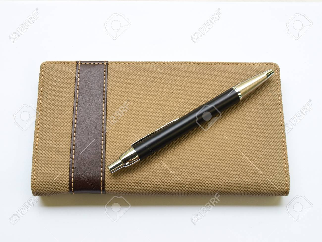 Light brown notebook and pen  cover isolated on white background Stock Photo - 17529488