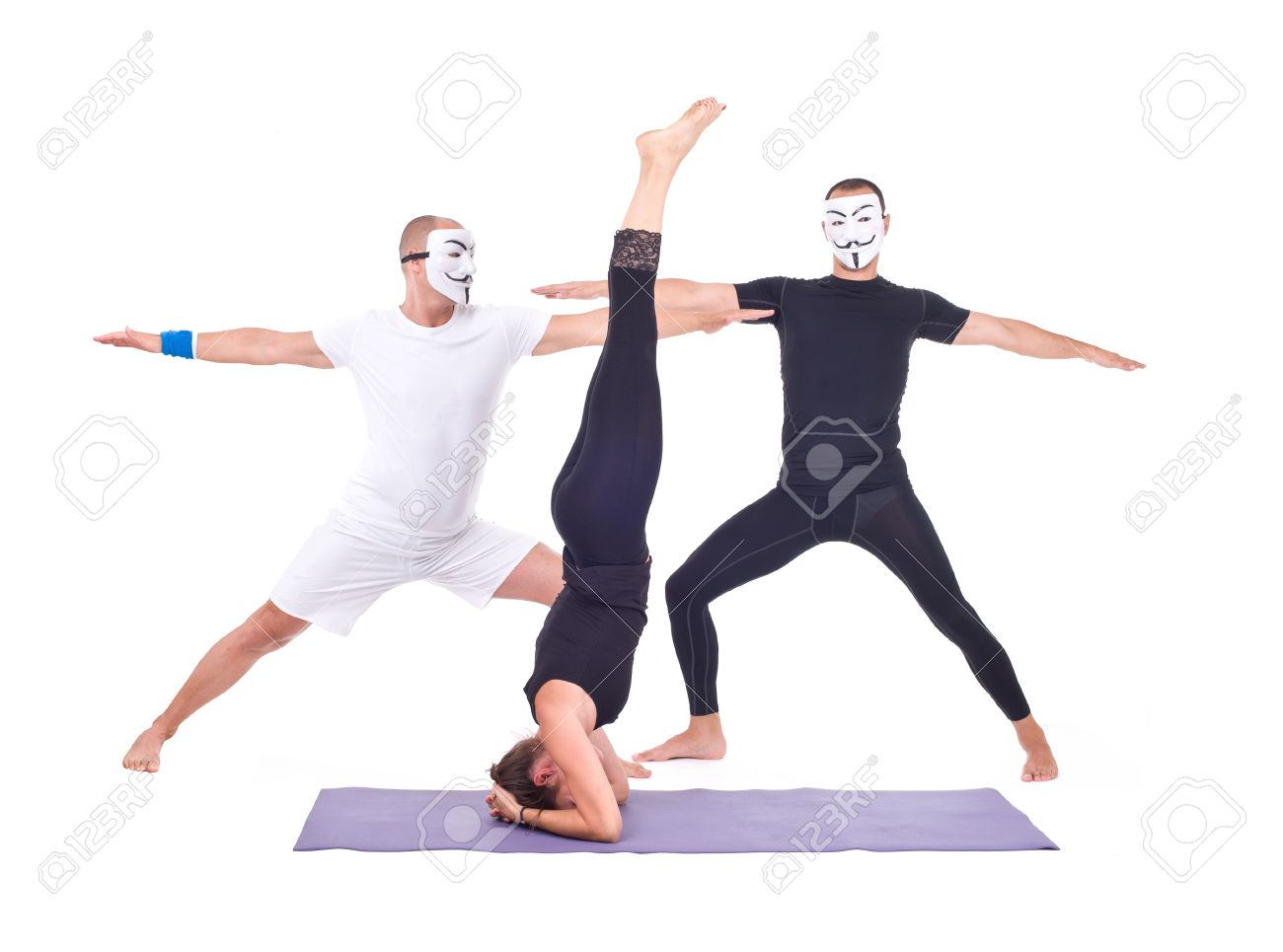 The Two Masked Men And Girl Doing Yoga Exercises In Studio On