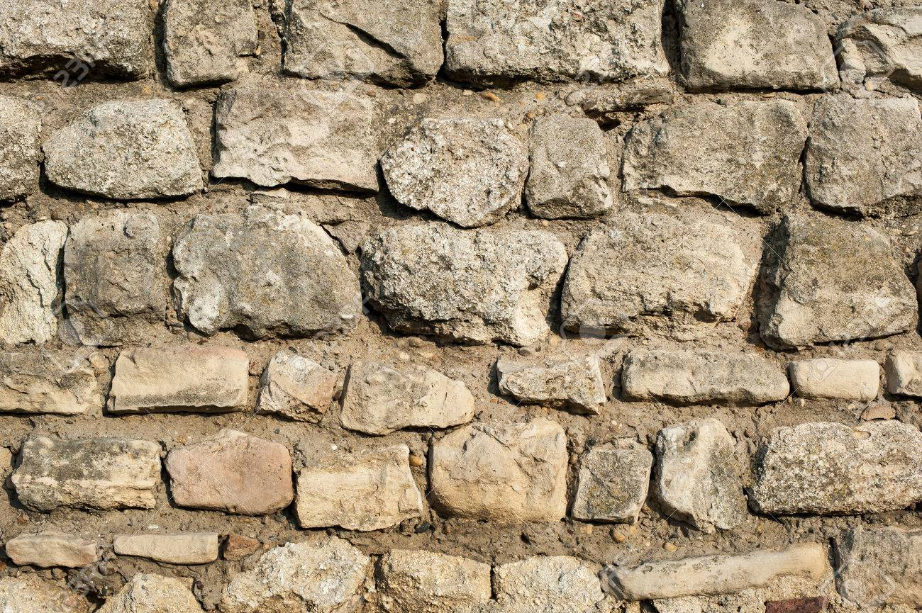 Stone Rock Wall. Texture Of Old Rock Wall For Background Stock Photo,  Picture And Royalty Free Image. Image 50578186.