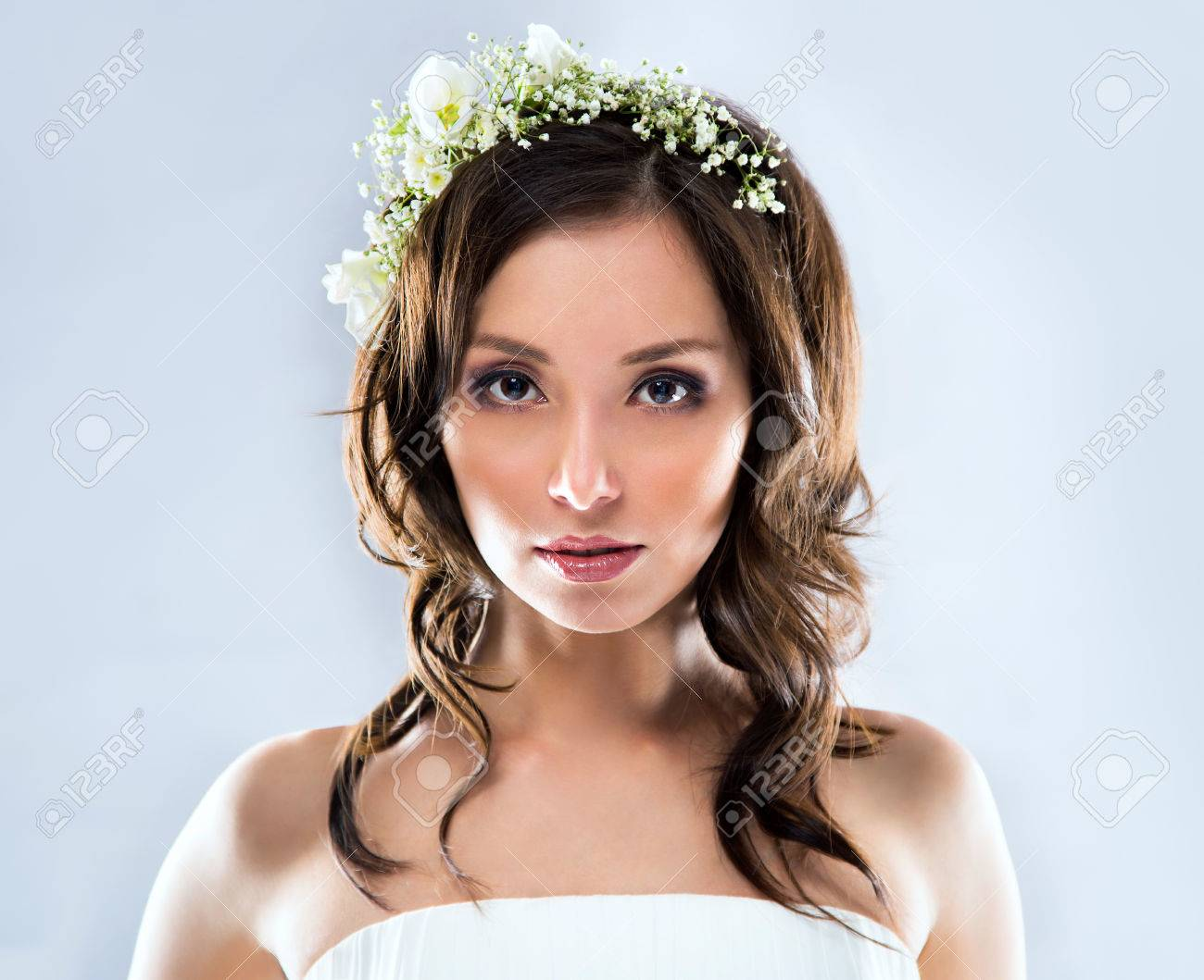 Beautiful Bride Wearing White Wedding Dress With Flowers On Her ...