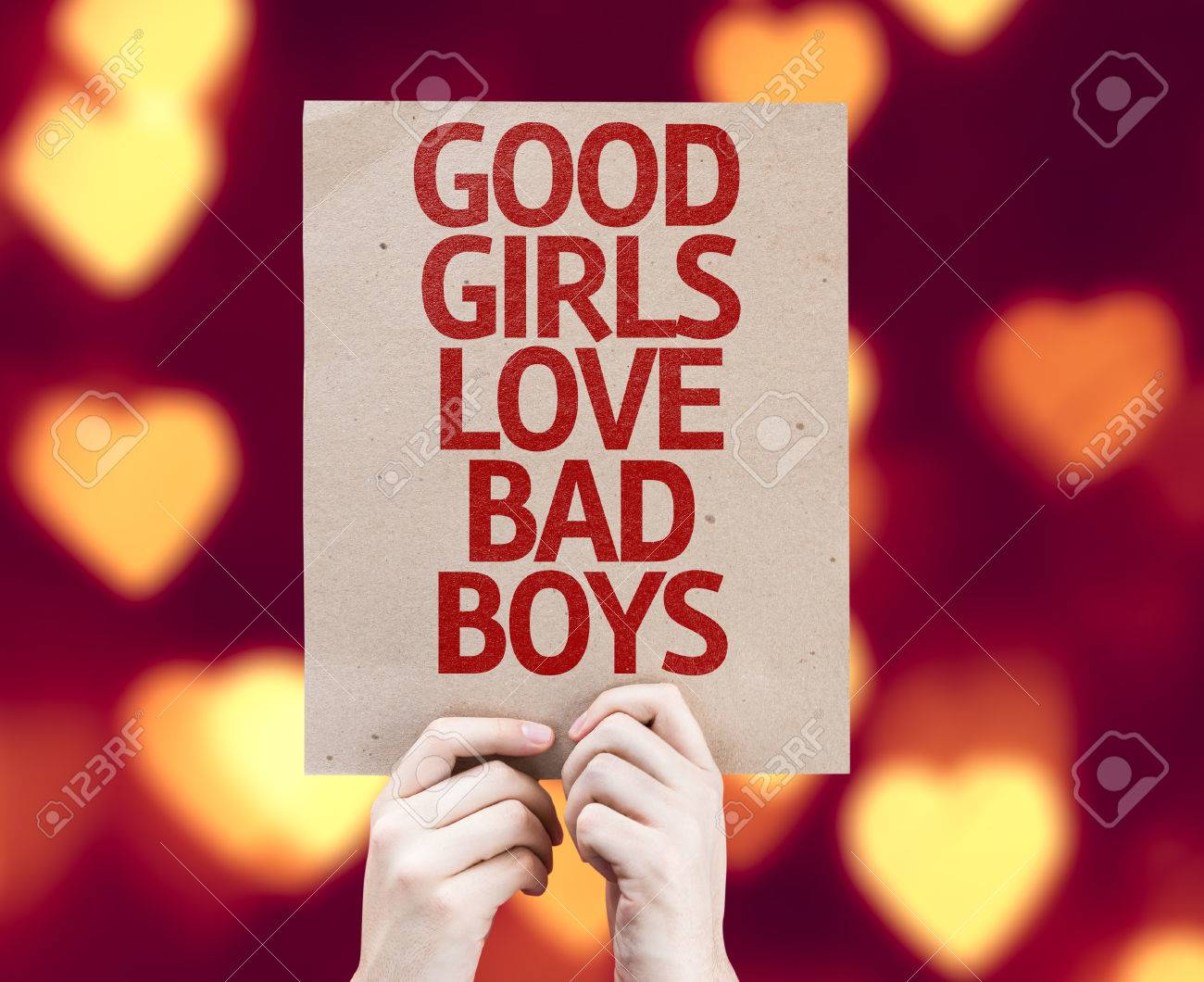 Hands Holding Cardboard With Good Girls Love Bad Boys On Heart ...