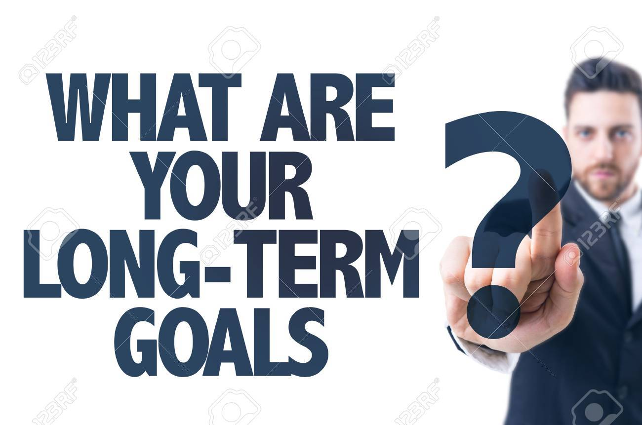 business man pointing the text what are your long term goals business man pointing the text what are your long term goals stock photo