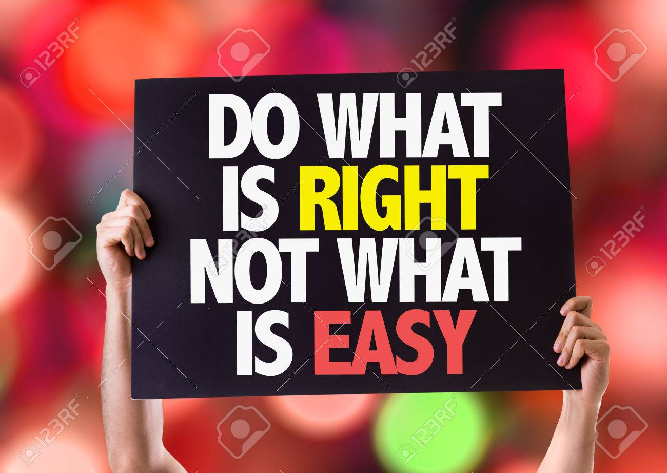 Hands holding card with text Do what is right not what is easy on bokeh background Stock Photo - 61002433