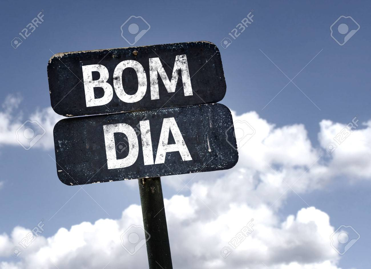 Good Morning In Portuguese On Sign With Clouds And Sky Background