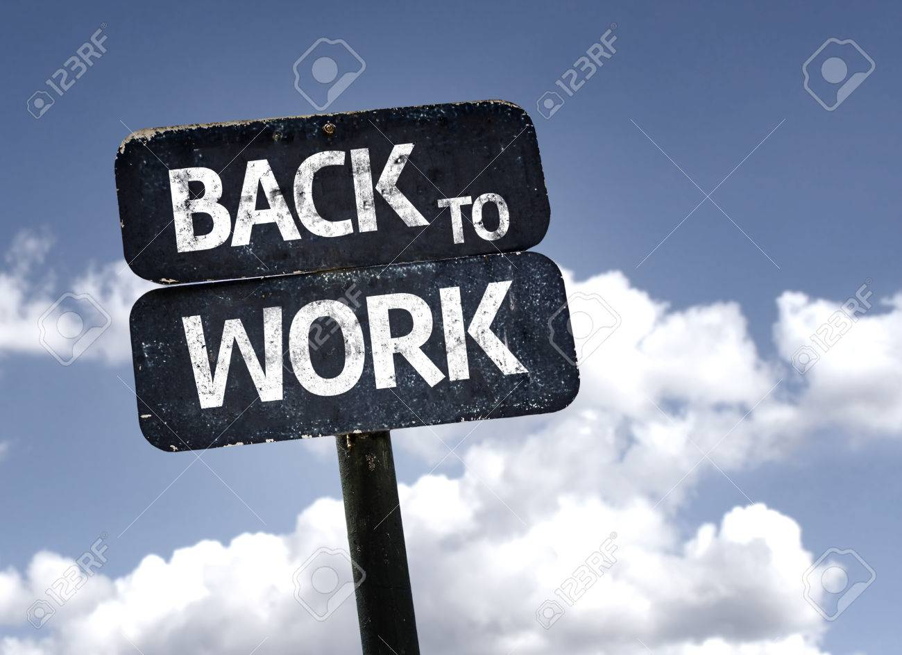 Back To Work : Back to work sign with clouds and sky background stock photo