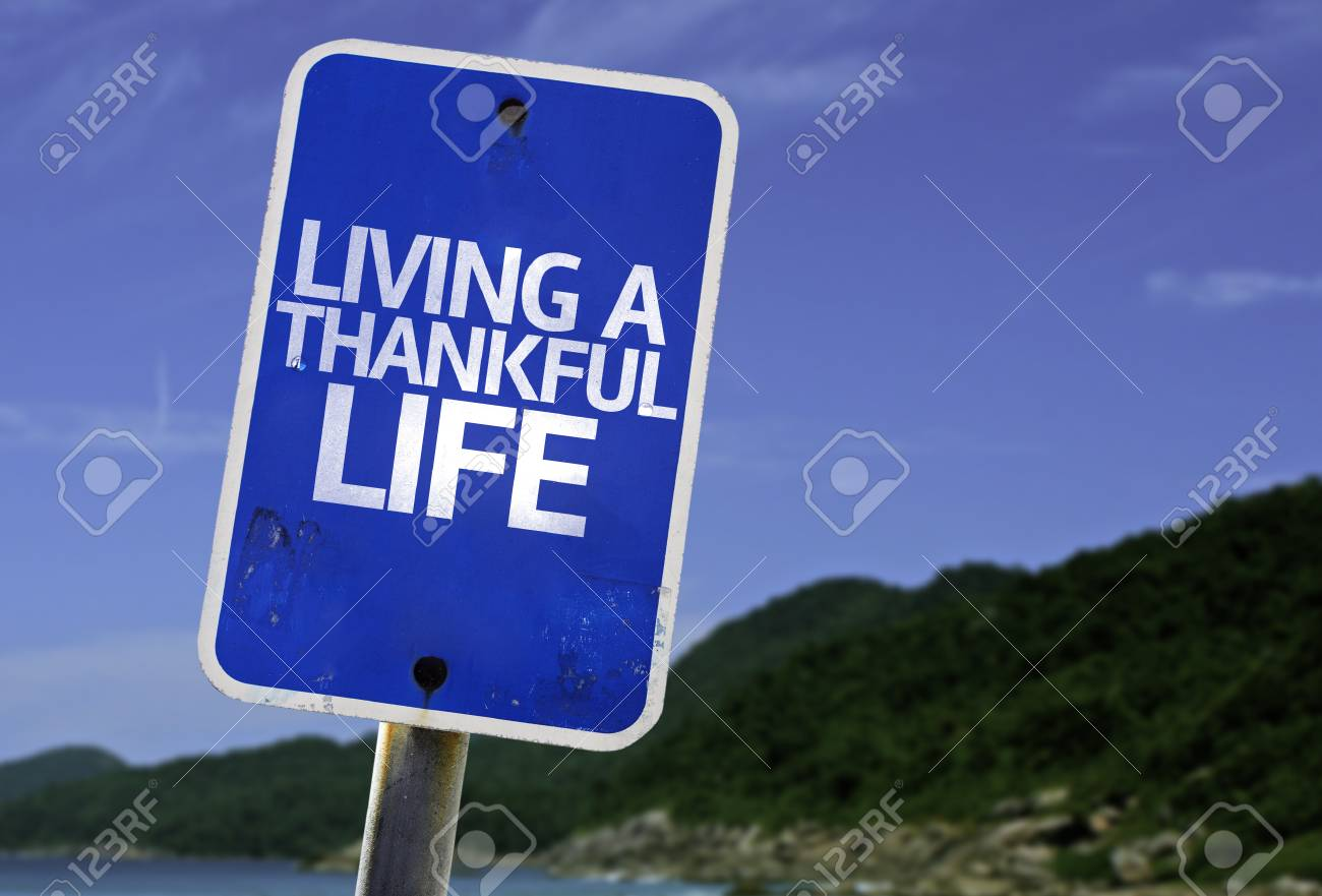 Living a thankful life sign with beach background stock photo living a thankful life sign with beach background stock photo 61508458 publicscrutiny Choice Image