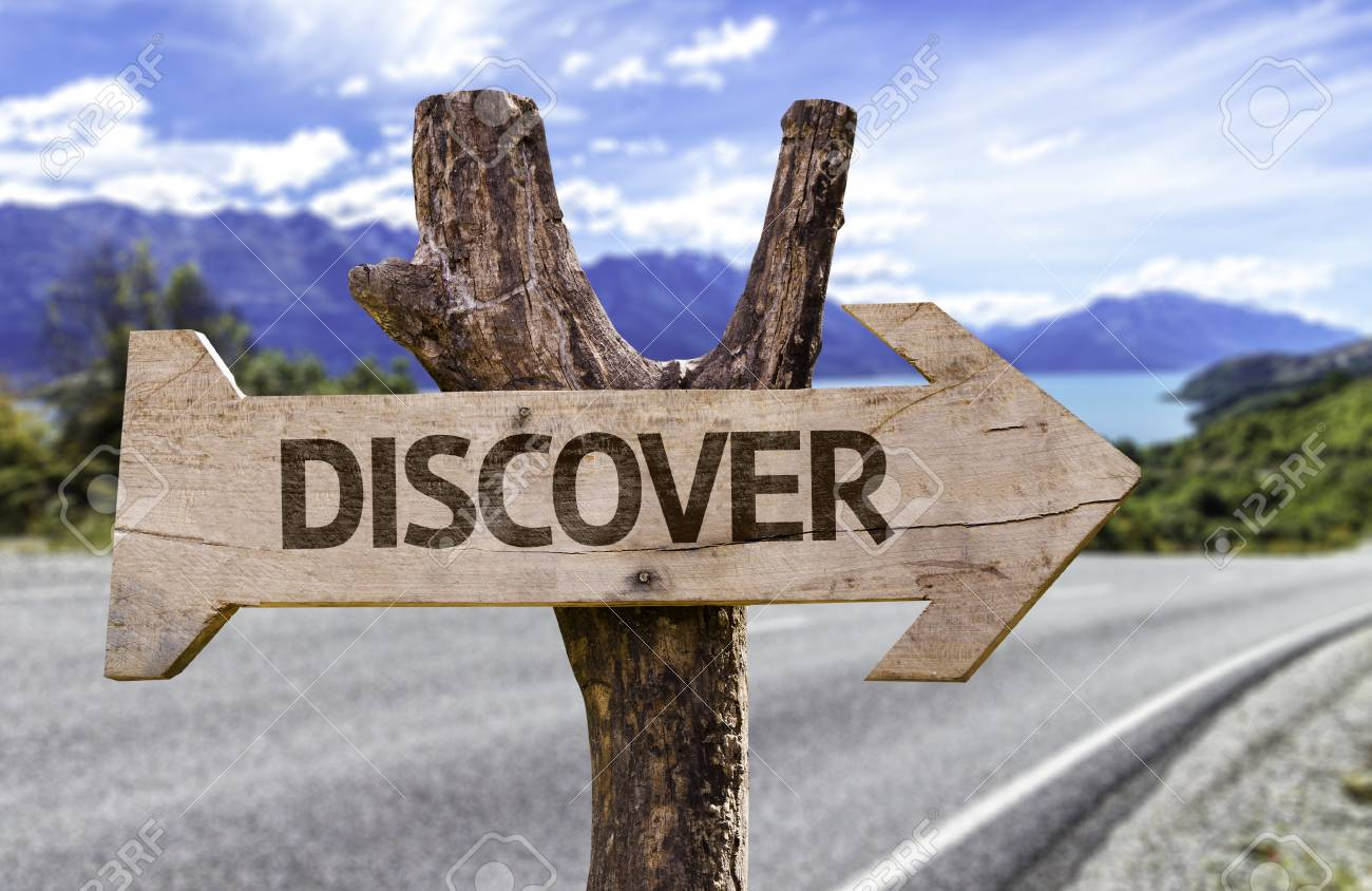 Discover sign with arrow on road background