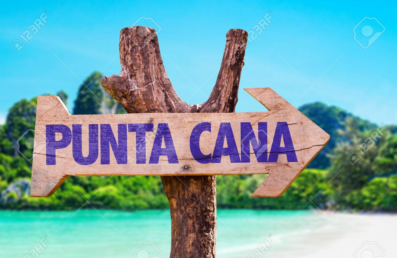 wooden sign board in wetland with text punta cana stock photo