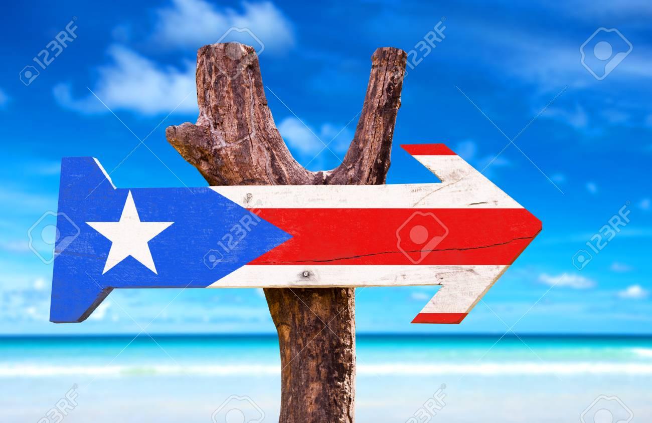 Puerto Rico Flag Sign With Arrow On Beach Background Stock Photo
