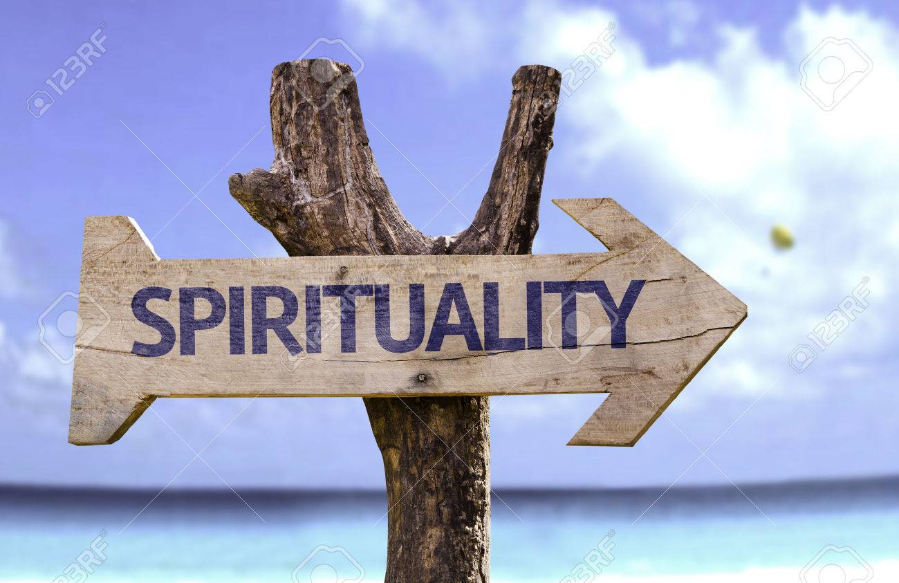 Spirituality sign with arrow on beach background - 62307998