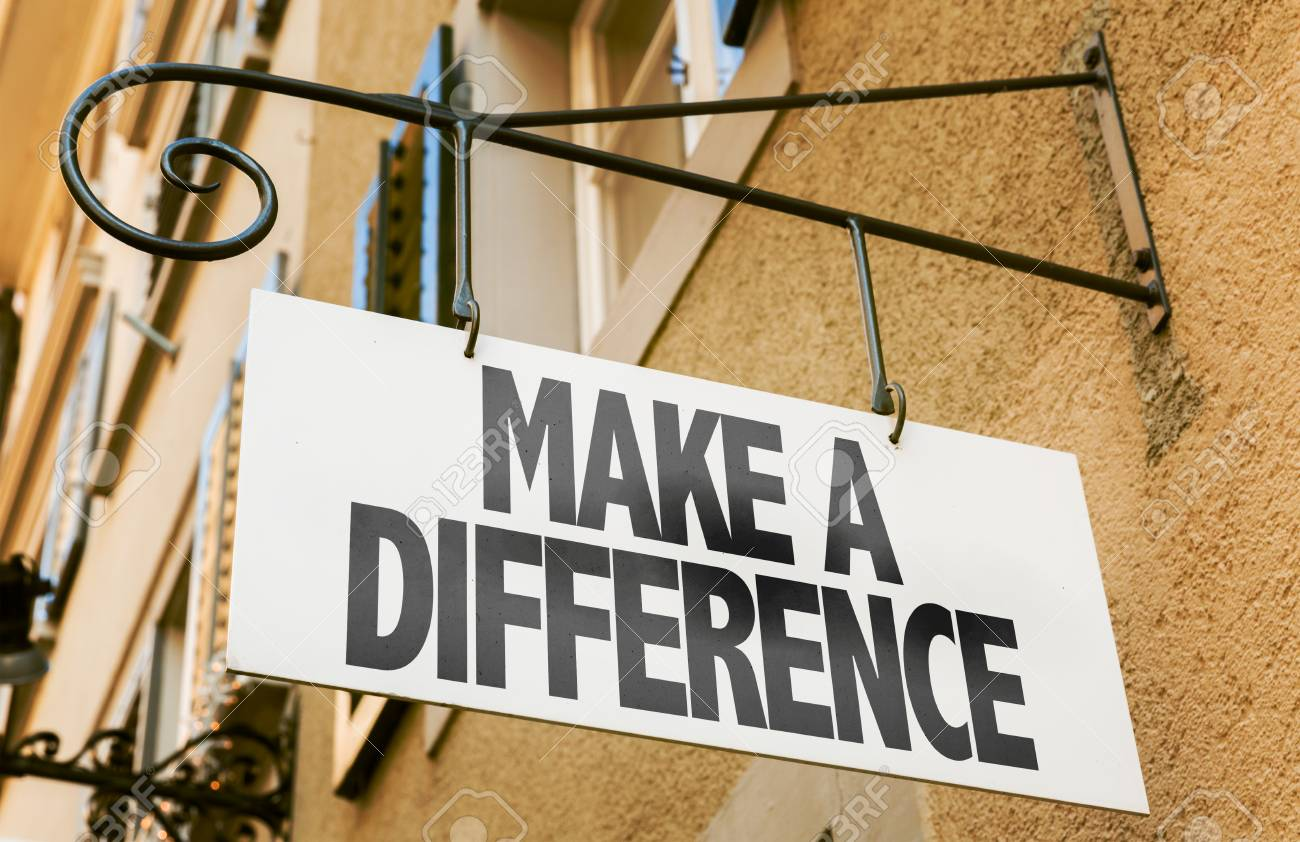Make a difference signpost on building background - 63388629