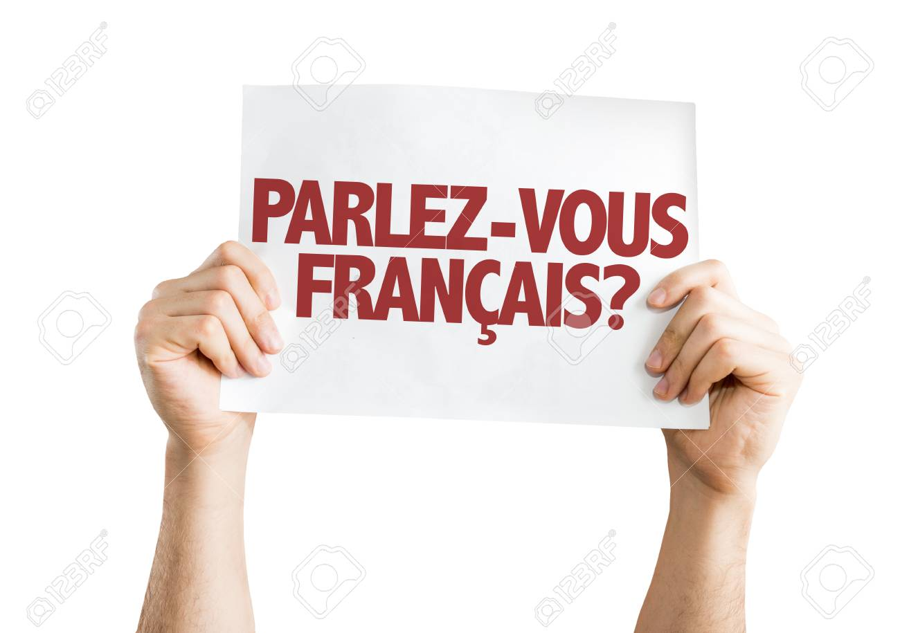 Hands Holding Cardboard On White Background With Text Parlez Vous Stock Photo Picture And Royalty Free Image Image 64070410