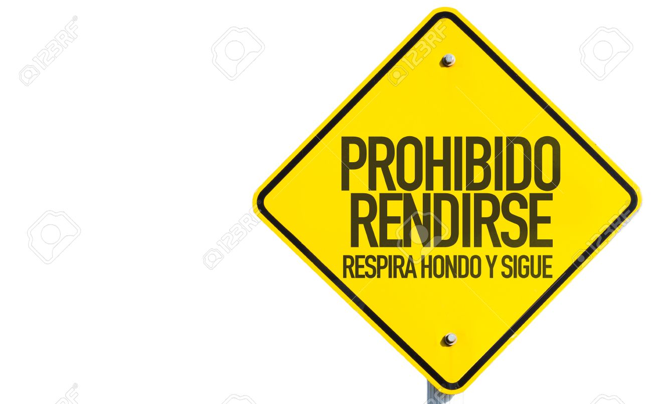 Prohibido rendirse respira hondo y sigue (don't surrender, take a deep breath and keep going in Spanish) sign on white background - 61394722