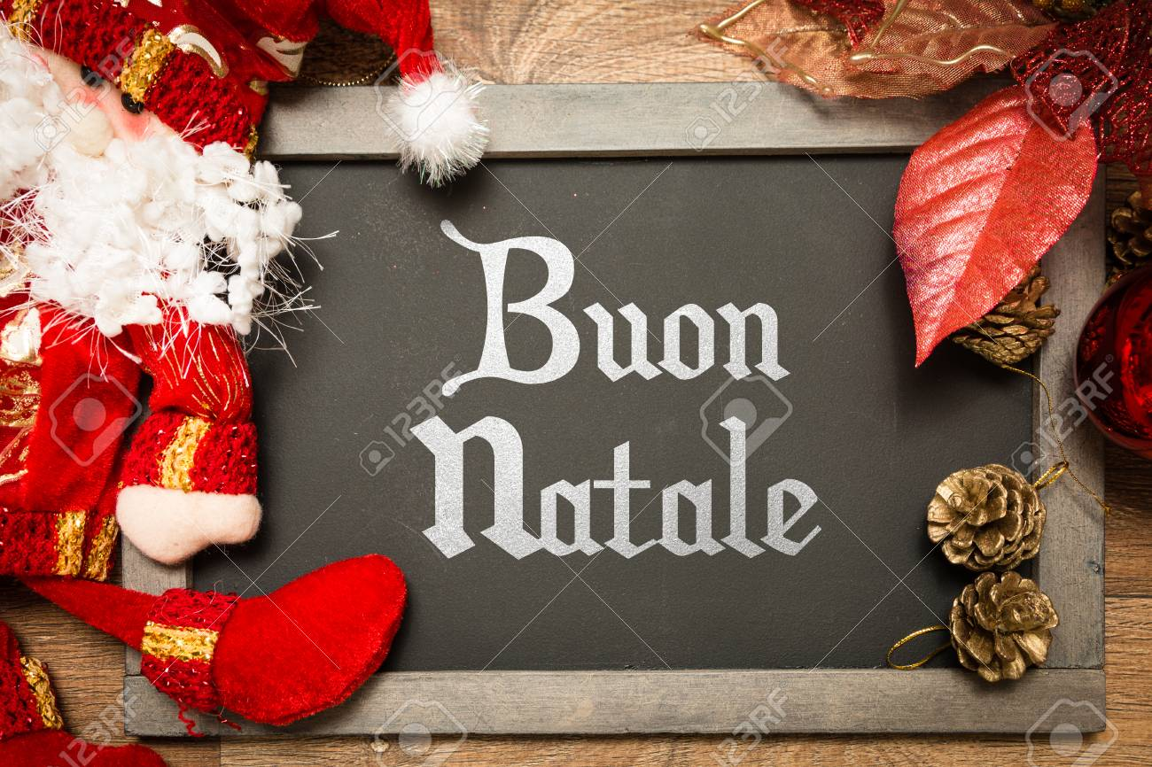 buon natale merry christmas in italian written on blackboard stock photo 64284974