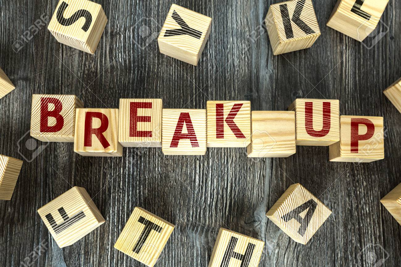 Break up written on a wooden cube background - 64368865