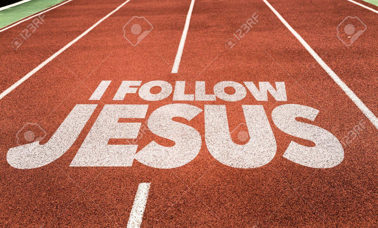 i follow jesus written on running track background stock photo