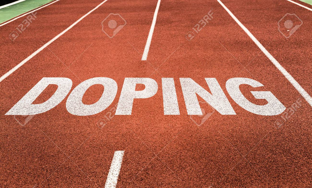 doping written on running track background stock photo picture and