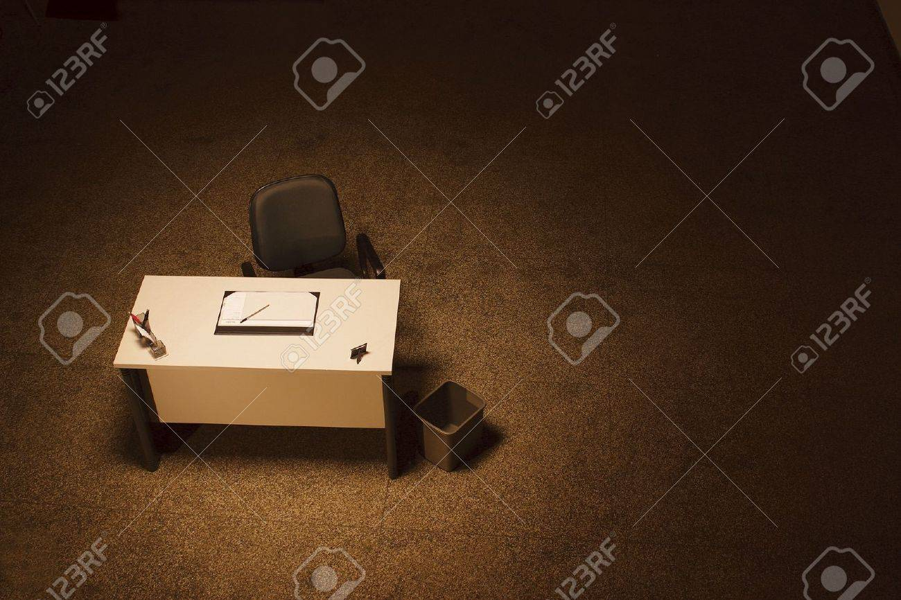 Single Office Desk In A Empty Room With Dark Grey Office Chair Stock Photo    9160266