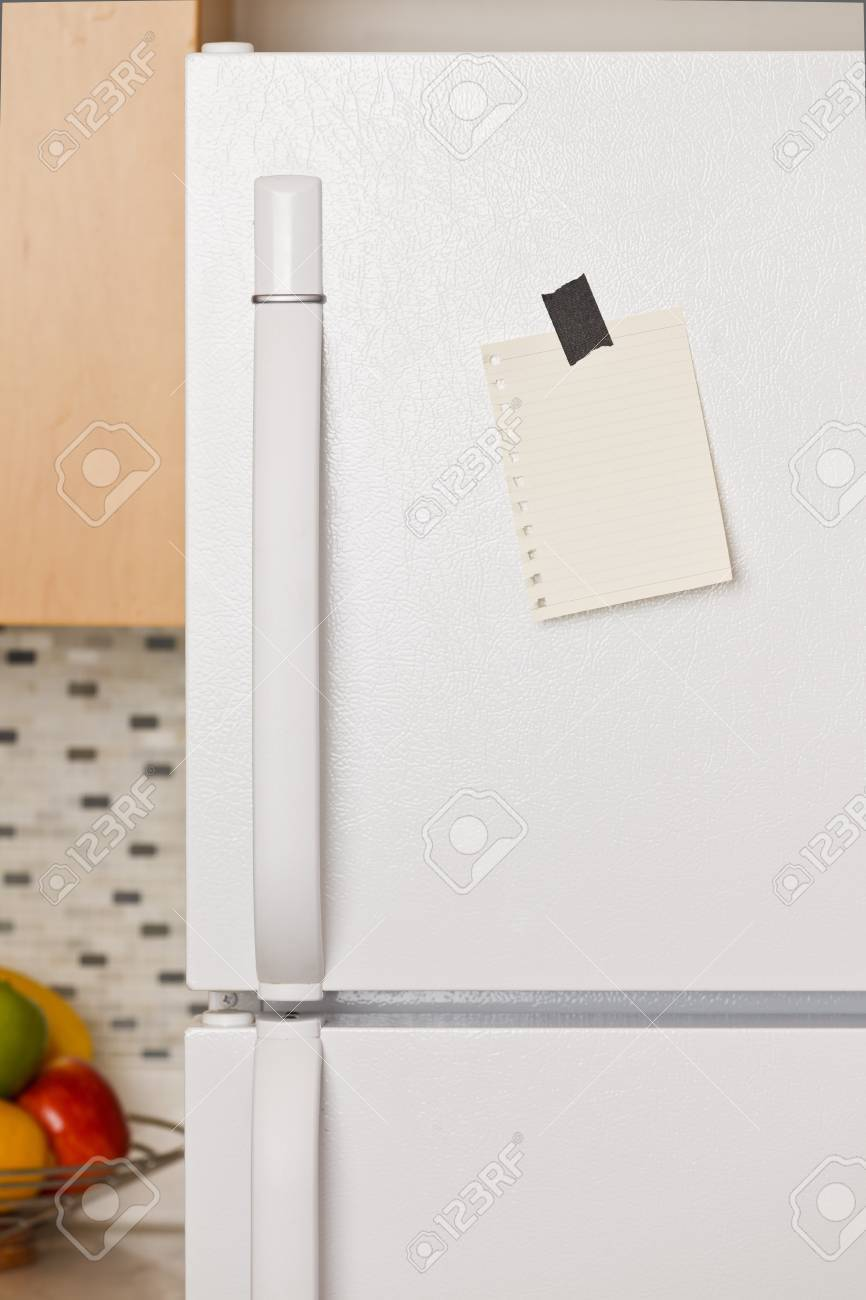 Piece of yellow paper taped to a refrigerator door Stock Photo - 9304001