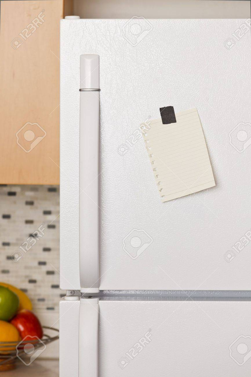 Piece of yellow paper taped to a refrigerator door Stock Photo - 9304010