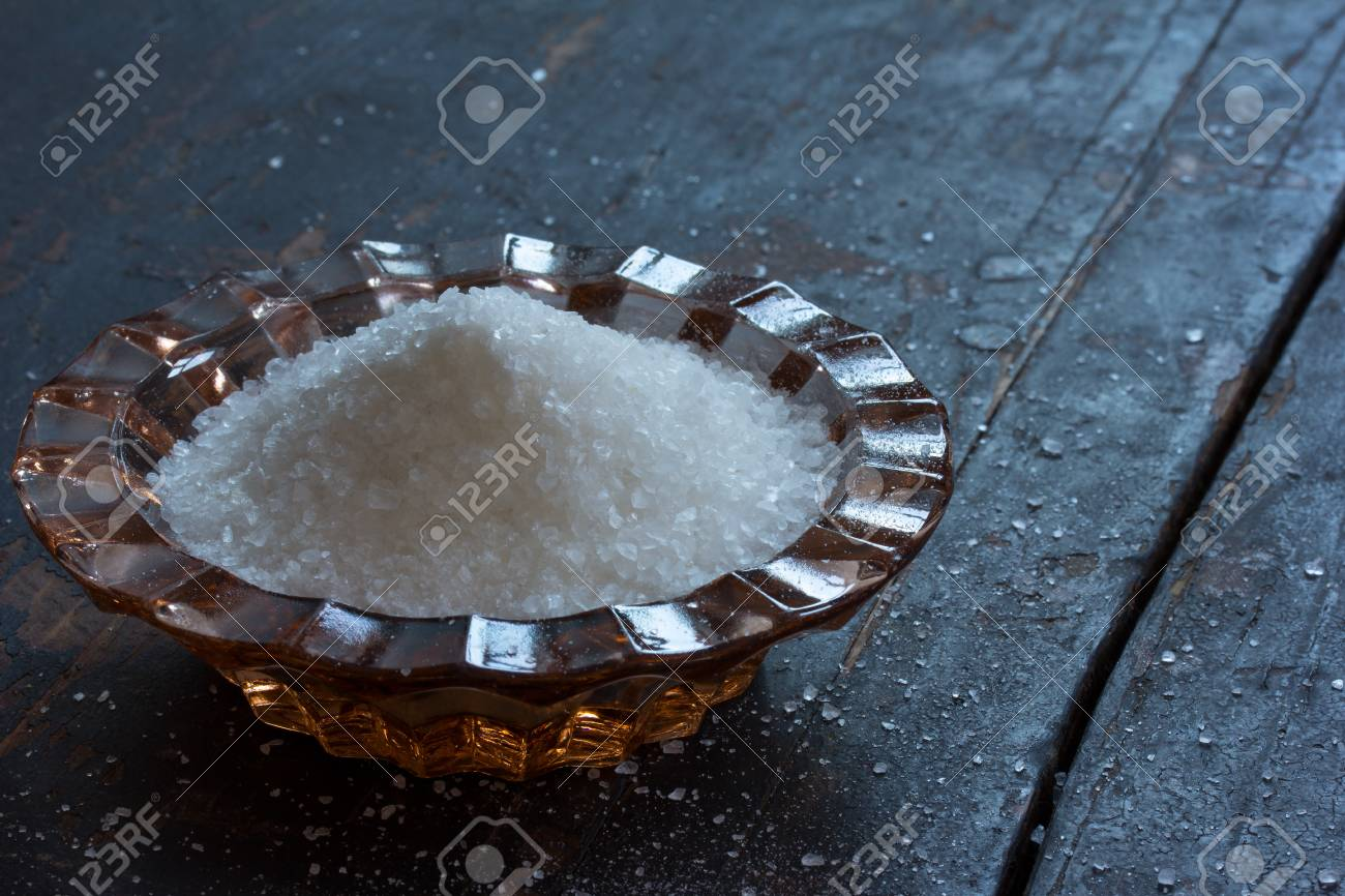 Food Cooking Sea Salt In A Glass Salt Shaker On An Old Black.. Stock ...