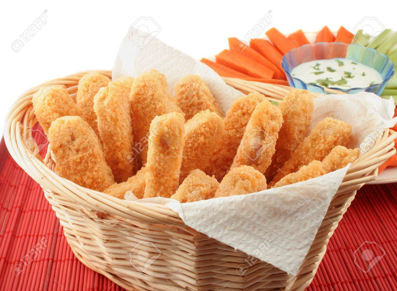 basket of crispy chicken fingers with platter of vegetables and dip Stock Photo - 616585