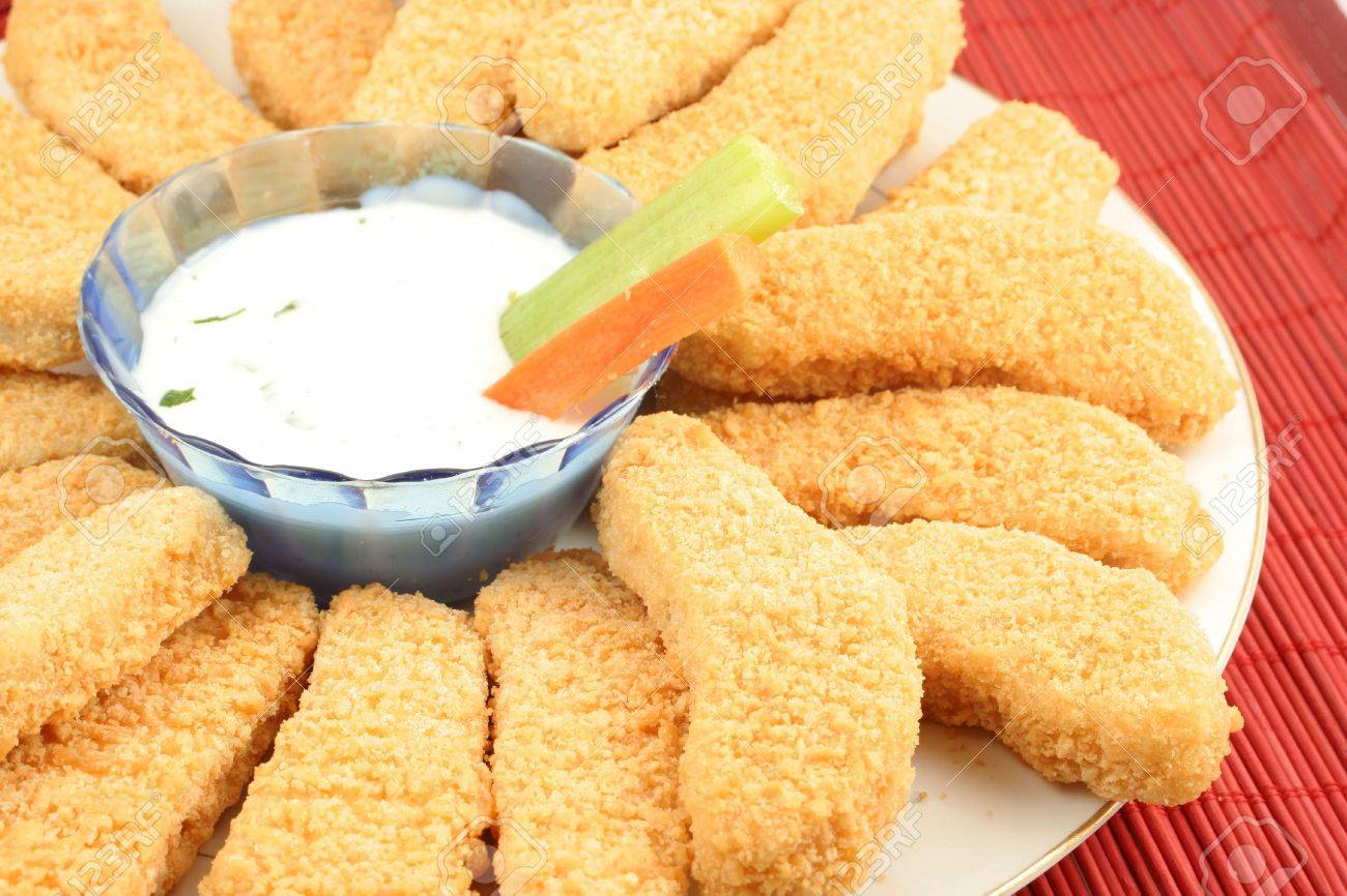 plate of crispy chicken fingers with  vegetables and dip Stock Photo - 615891