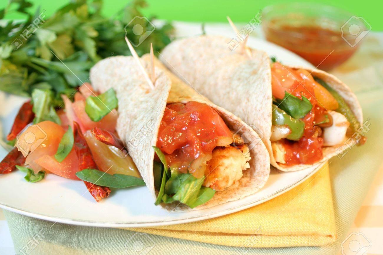 delicious and colorful  mexican style  whole wheat chicken fajitas with vegetables, and salsa Stock Photo - 2709506