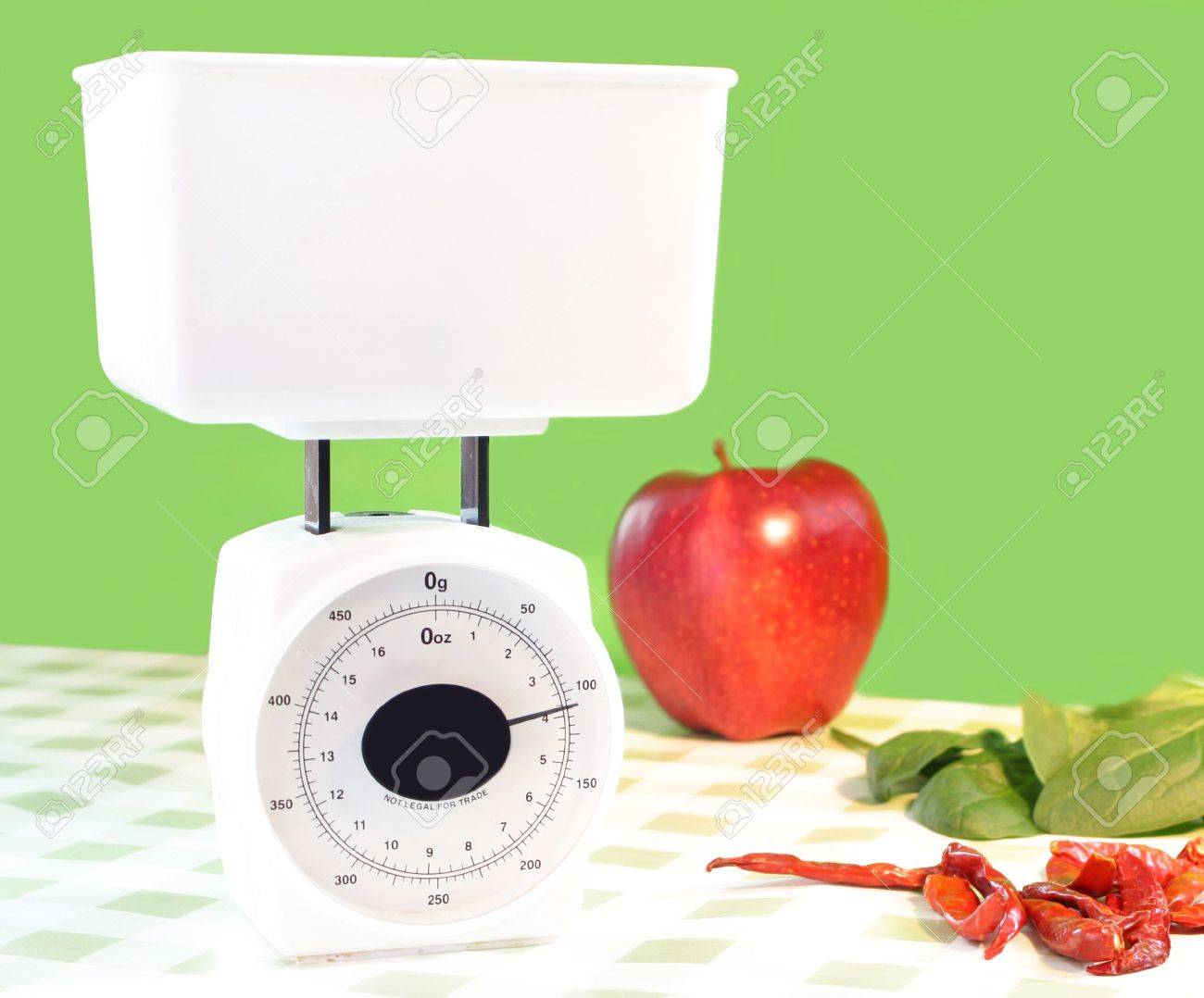 white food scale stating that something inside weighs 4 grams