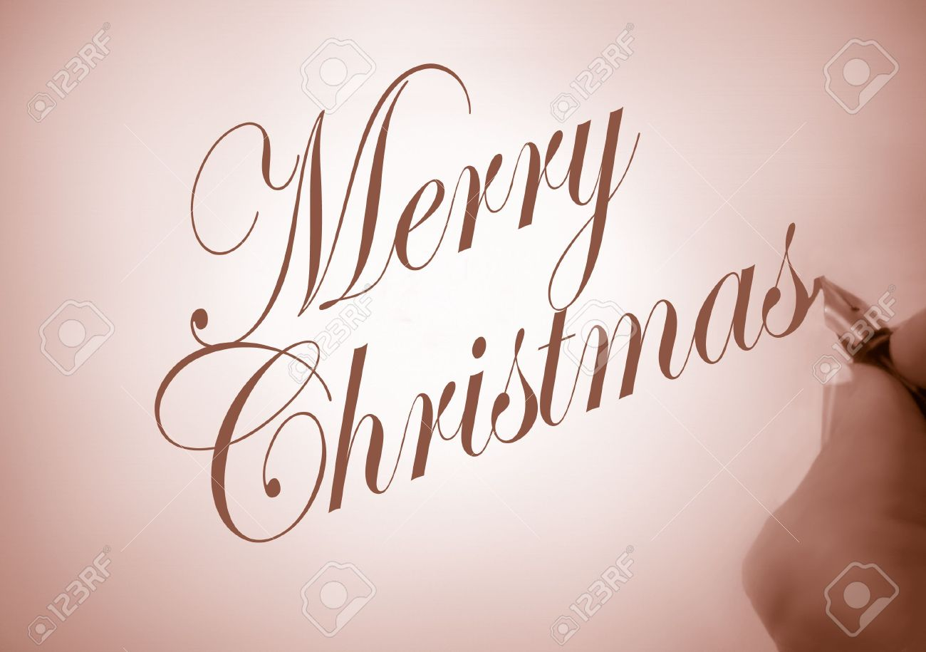 Merry Christmas Writing.Person Writing Merry Christmas In Calligraphy In Sepia