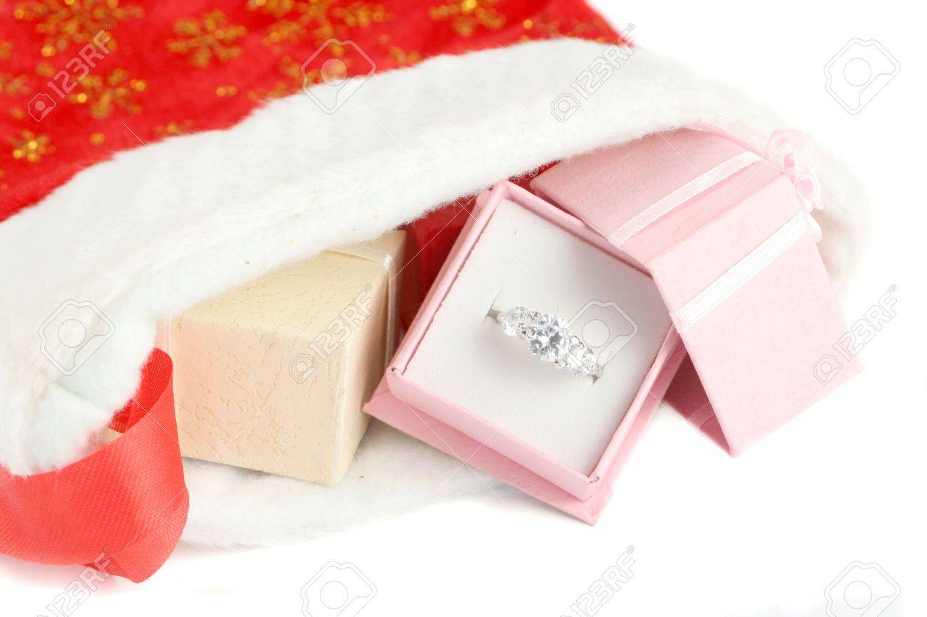 Christmas Stocking With Small Gift Boxes, The Pink Box Holds A Diamond  Engagement Ring Stock