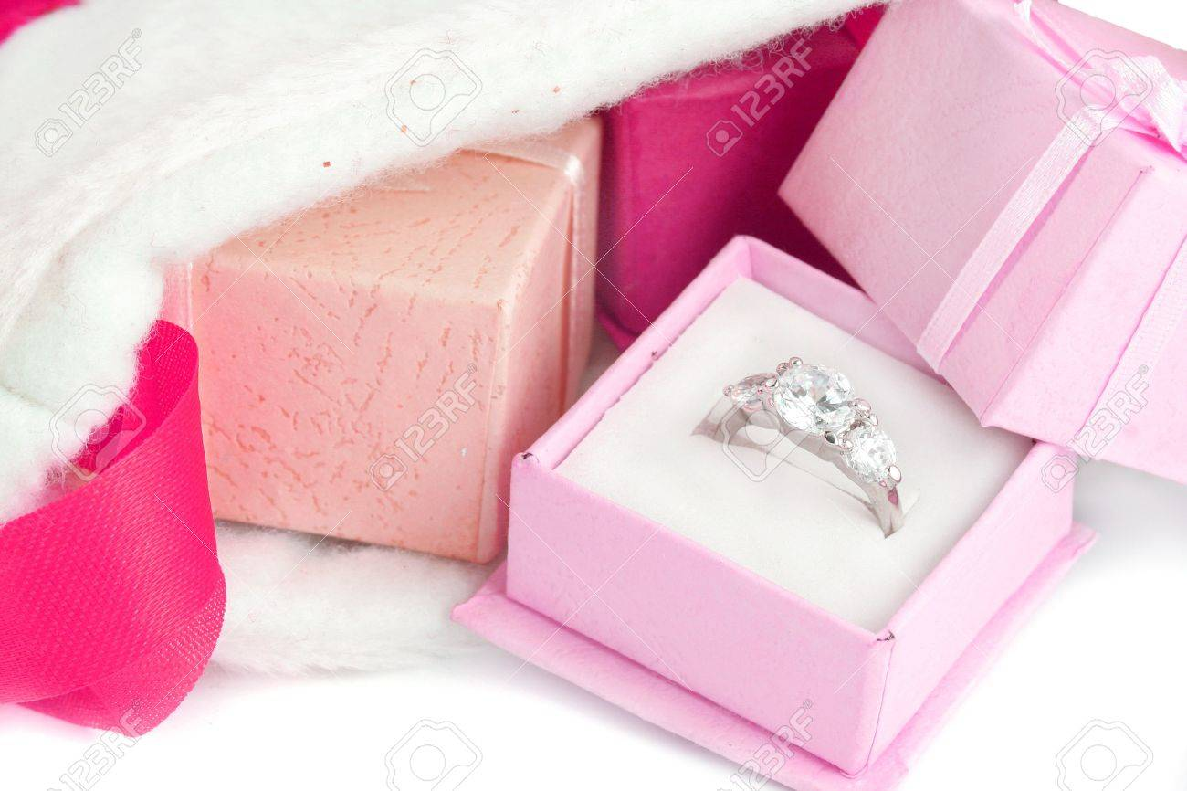 Christmas Stocking With Small Gift Boxes, The Pink Box Holds A Diamond  Engagement Ring In