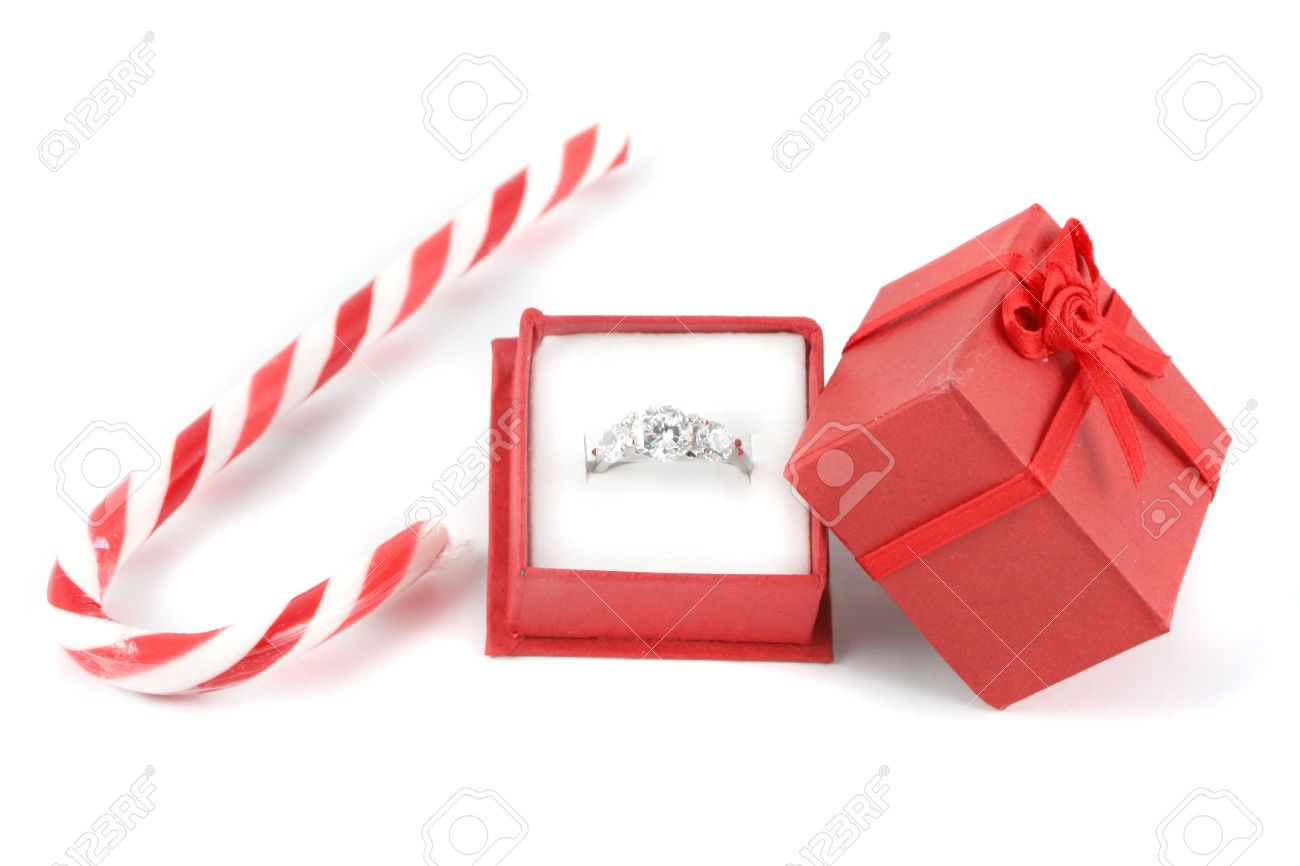 Stock Photo  Christmas Candy Cane With Small Red Gift Box Holding A Diamond  Engagement Ring