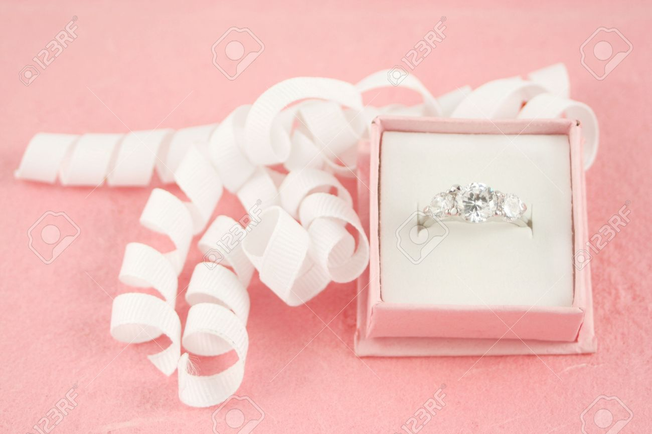 Pink Gift Jewelry Box Holds A Diamond Engagement Ring With Ribbon ...