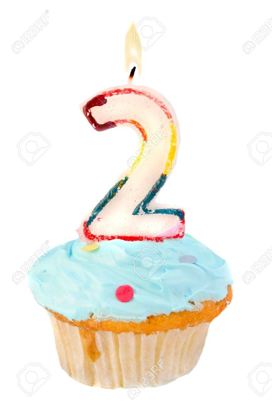 second birthday cupcake with blue frosting on a white background Stock Photo - 5599561