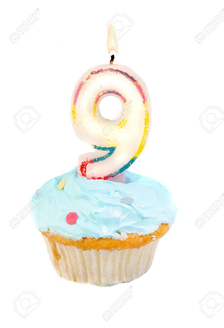 ninth birthday cupcake with blue frosting on a white background Stock Photo - 5599567