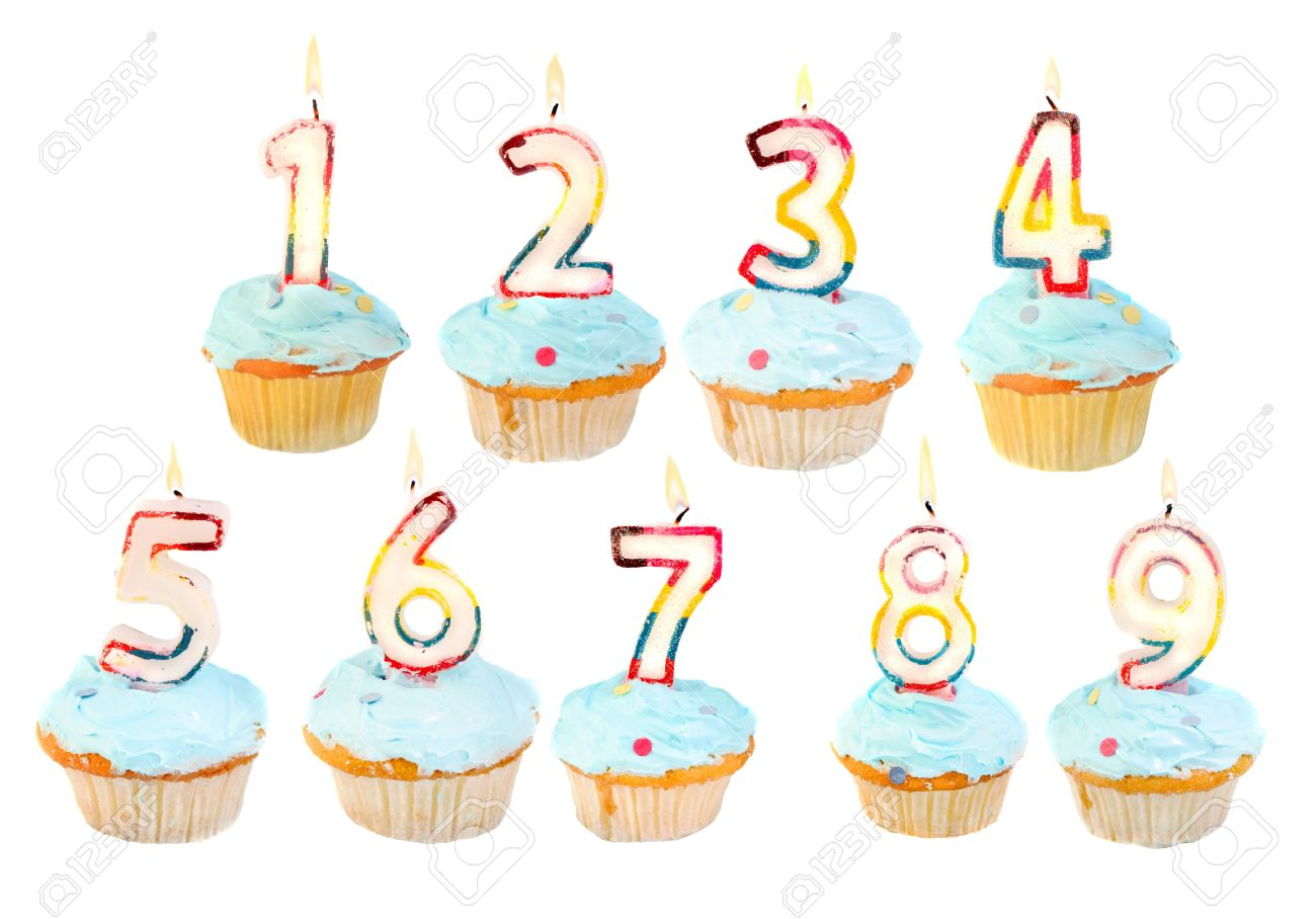 A Set Of Birthday Cupcakes With Lit Candles Numbers 1 To 9 Stock Photo