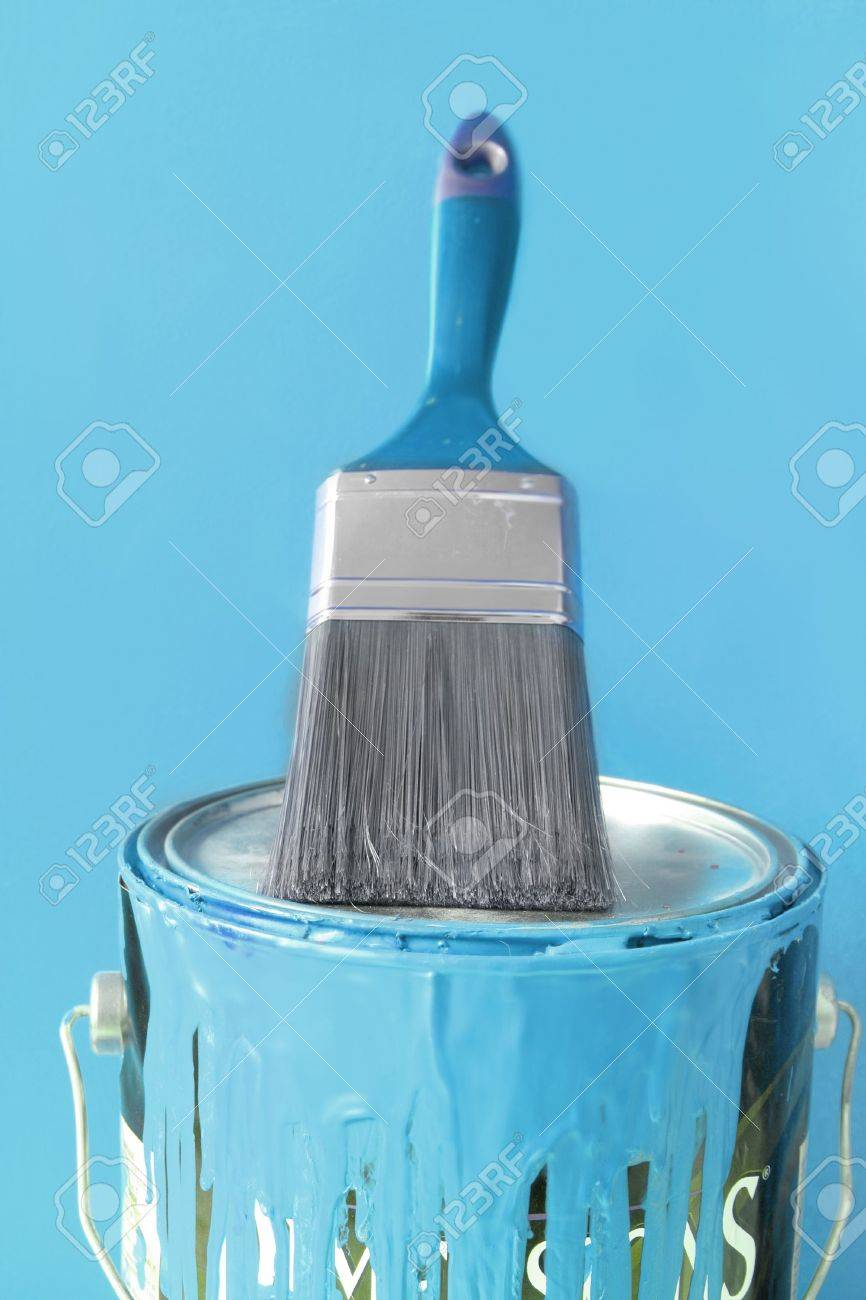 Light Blue Paint Paintbrush On Top Of Light Blue Paint Can For Diy Home Decorating