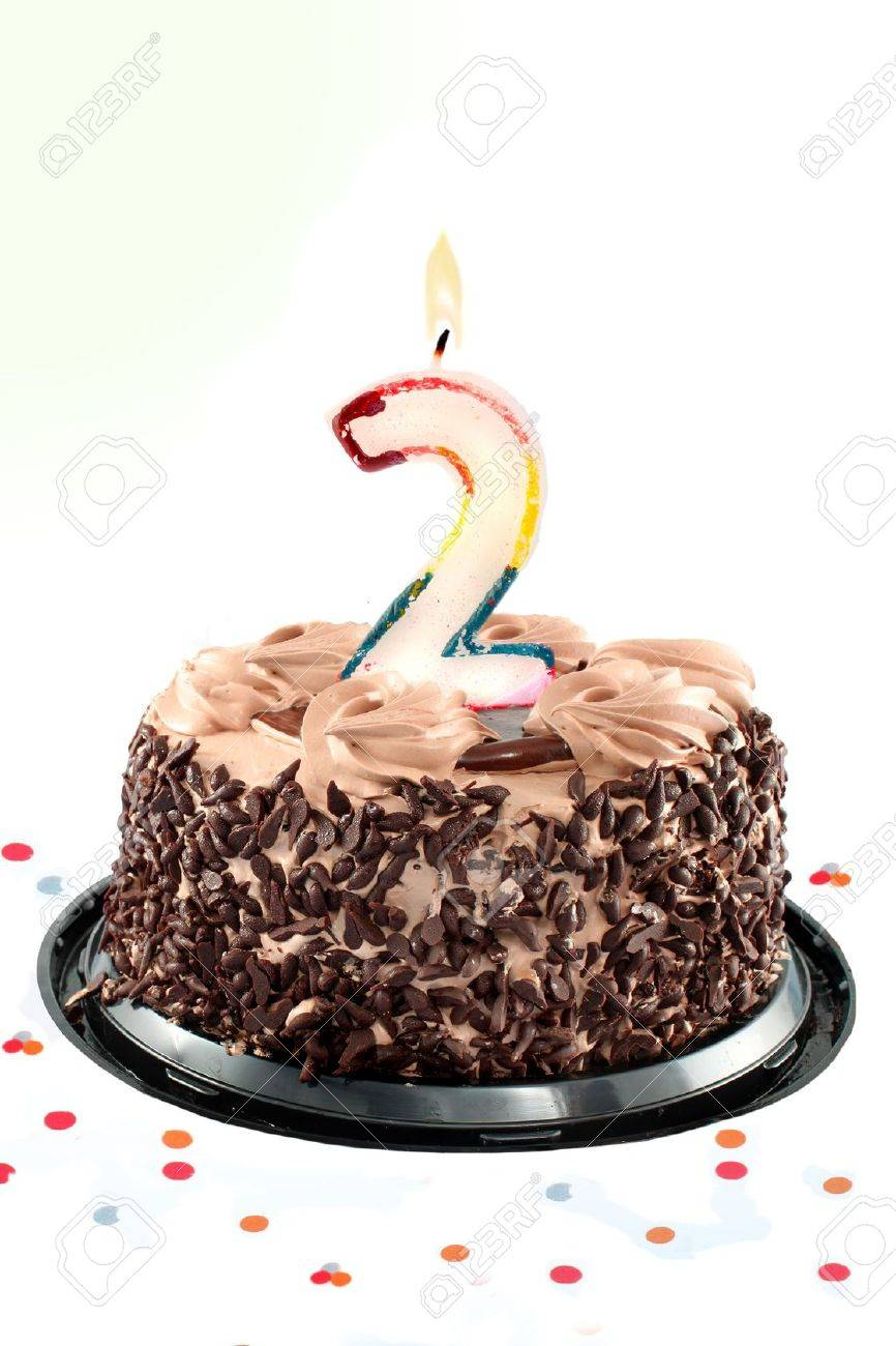 Surprising Chocolate Birthday Cake Surrounded By Confetti With Lit Candle Funny Birthday Cards Online Chimdamsfinfo
