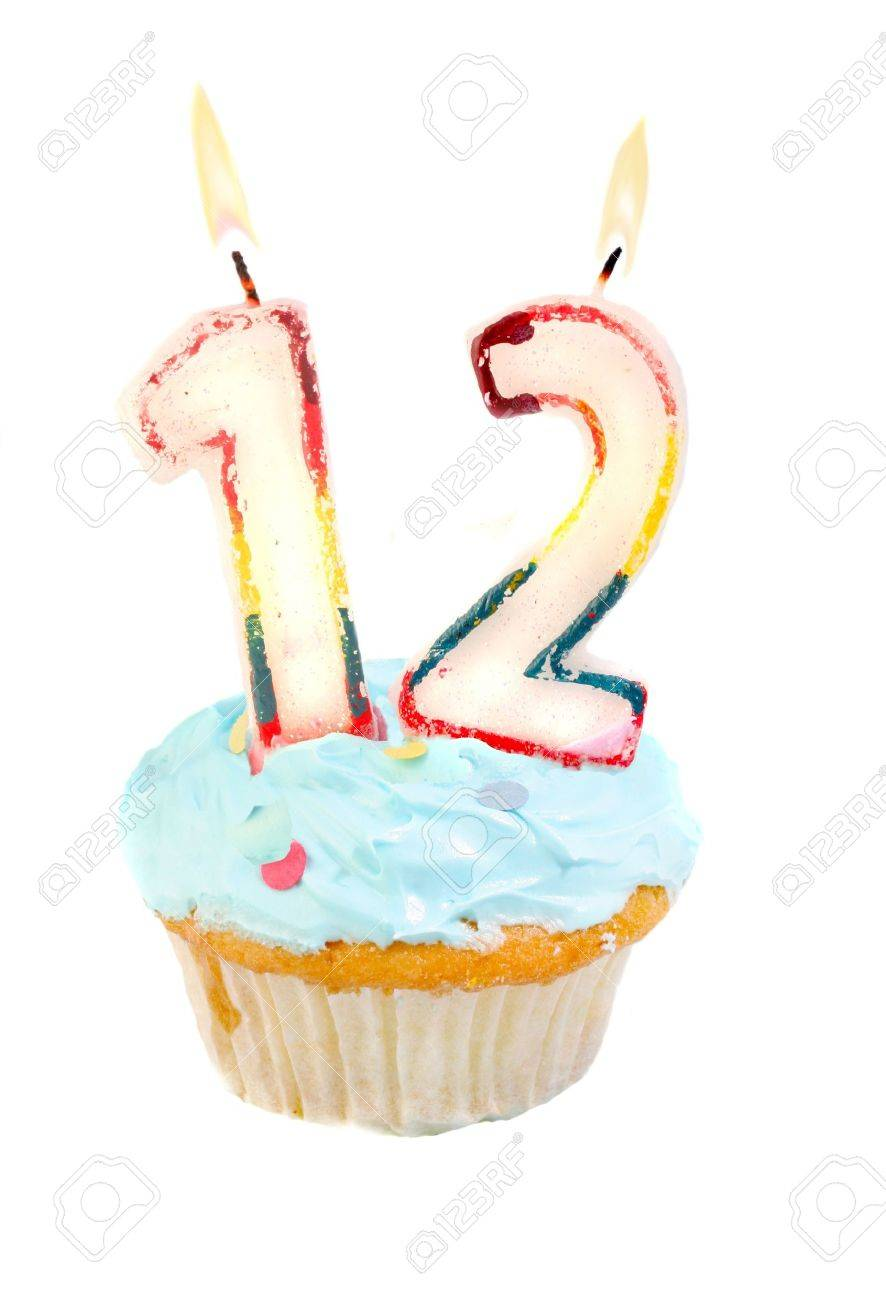 Twelveth birthday cupcake with blue frosting on a white background Stock Photo - 6972070
