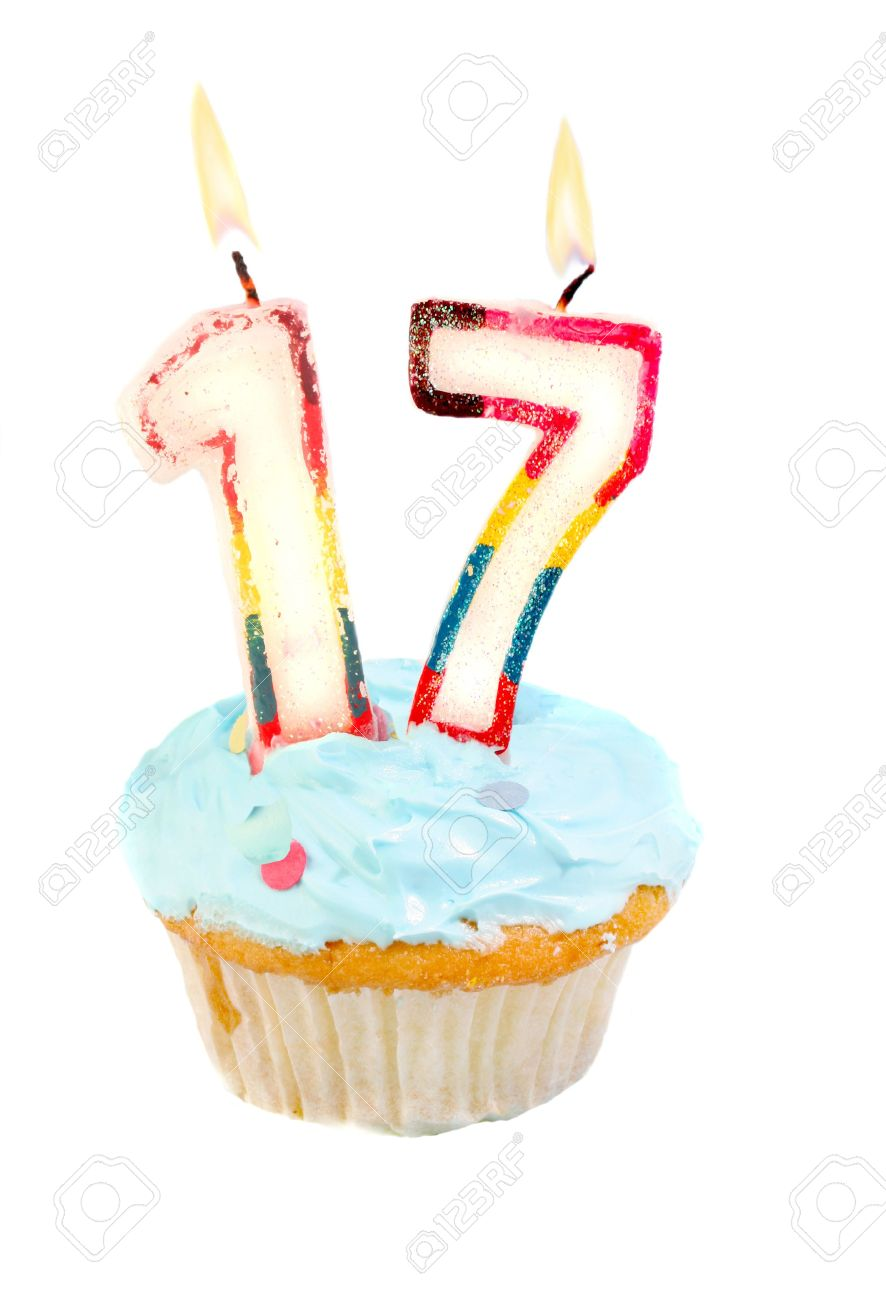 Seventeenth birthday cupcake with blue frosting on a white background Stock Photo - 6972073