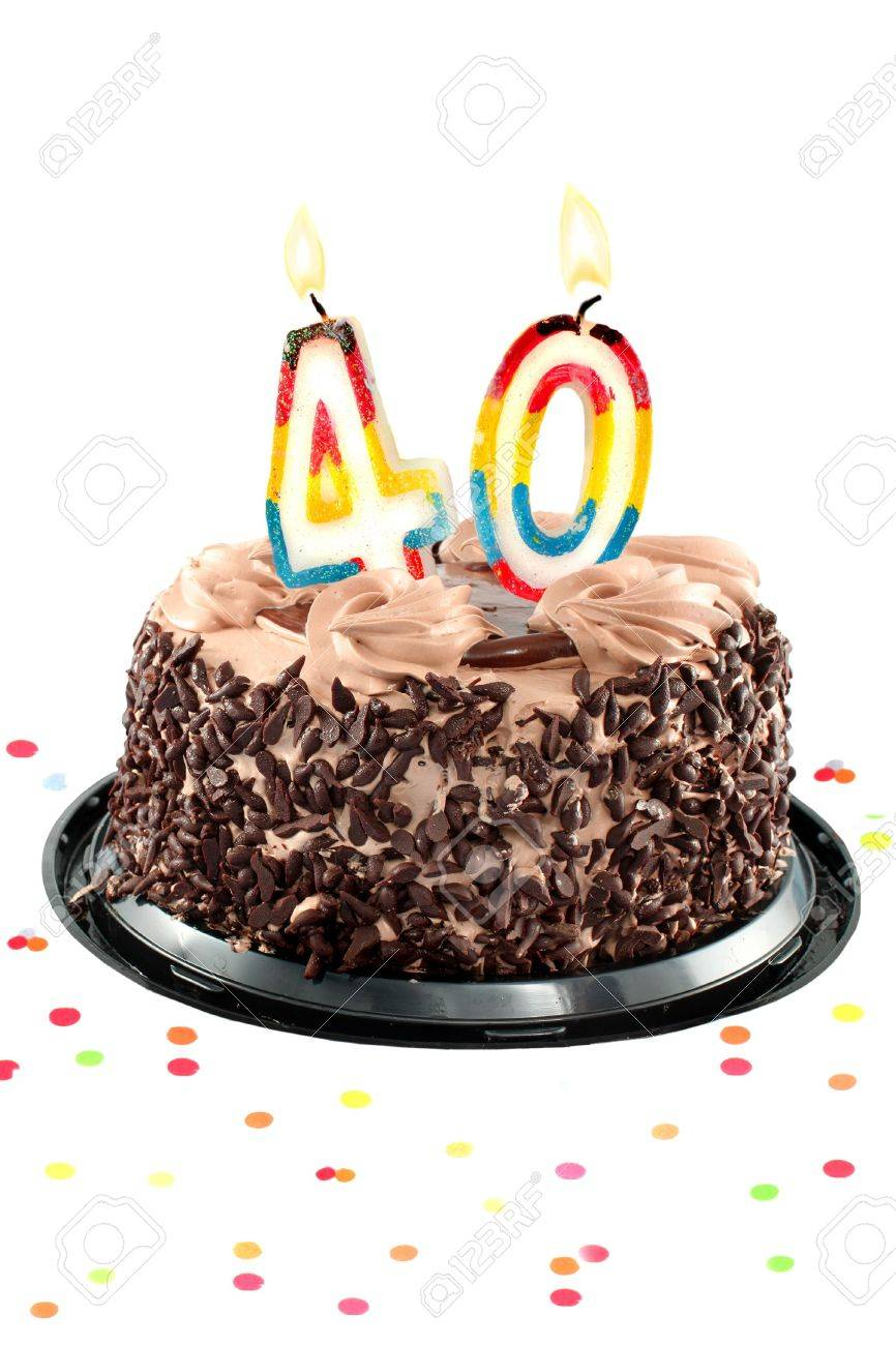 Chocolate birthday cake surrounded by confetti with lit candle for a fortieth birthday or anniversary celebration Stock Photo - 6972135